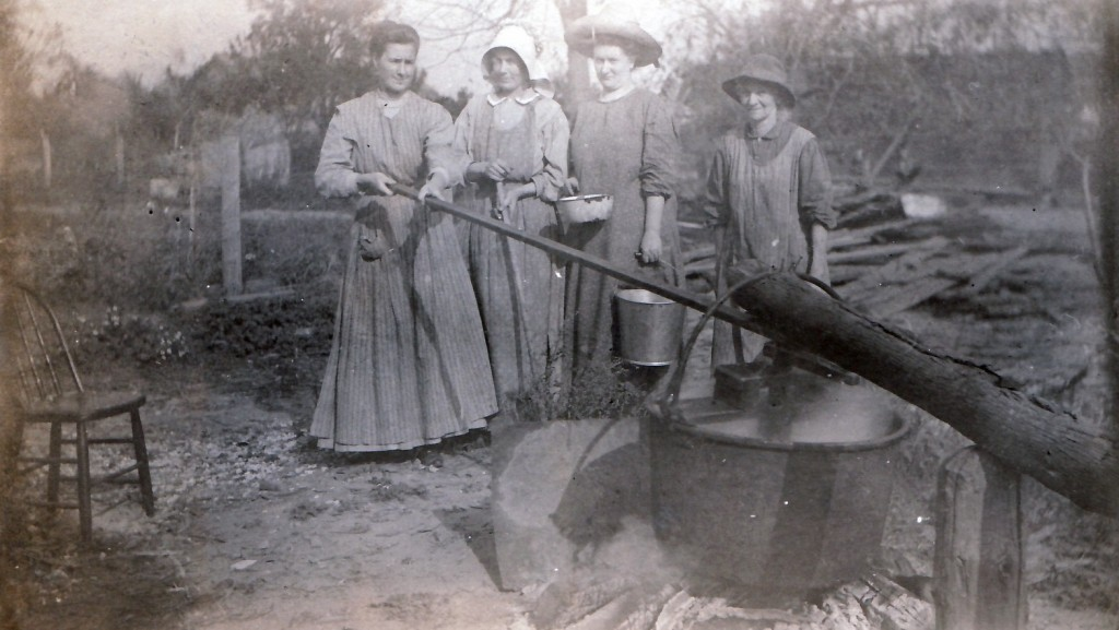 Making apple butter circa 1910