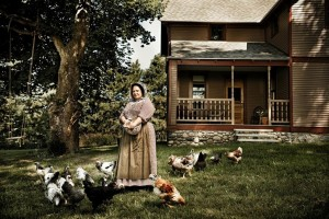 Proprietress Susan Odom feeding the chickens in the yard