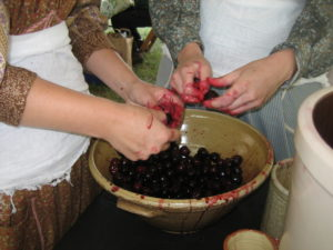 Aprons are in order when pitting cherries.